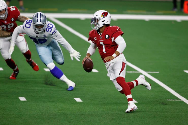 Arizona Cardinals quarterback Kyler Murray rushes with the ball against the Dallas Cowboys.