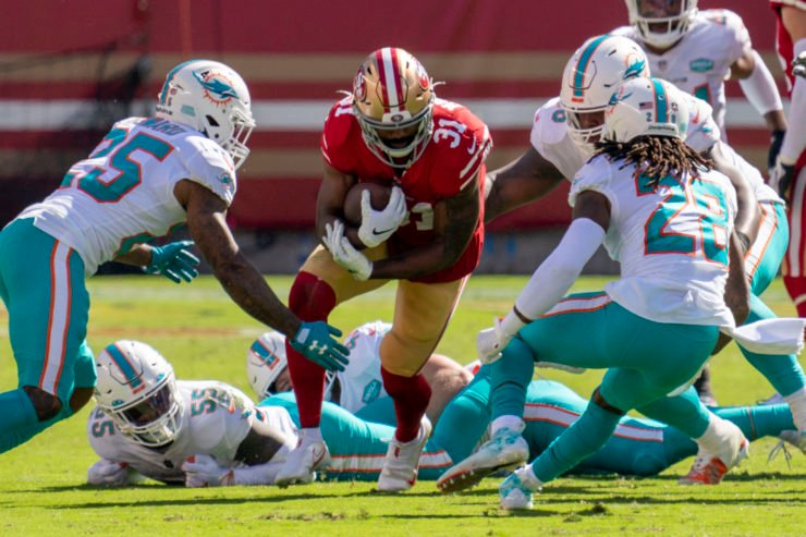 San Francisco 49ers running back Raheem Mostert attempts to rush with the ball against Miami Dolphins.