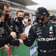 Mercedes' Lewis Hamilton celebrates with his team after winning the race