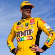 Kyle Busch looks on prior to the Hollywood Casino 400 race in Kansas