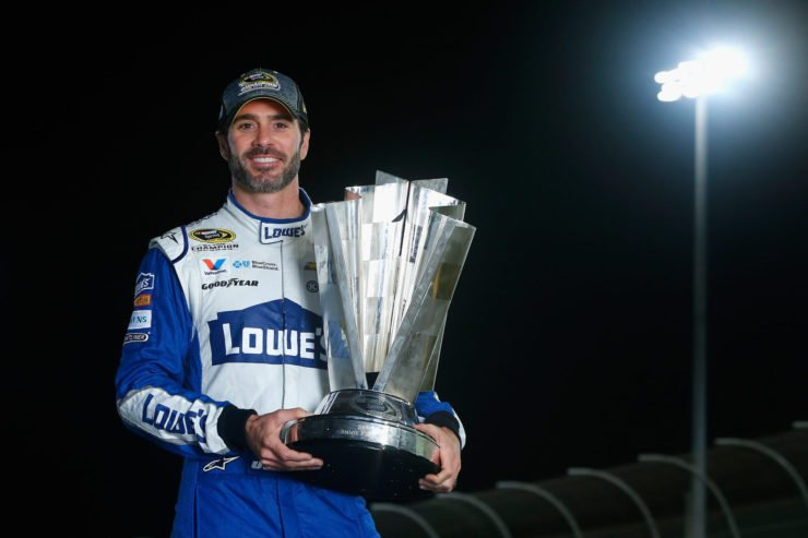 Seven-time NASCAR Cup Series champion Jimmie Johnson holds his trophy