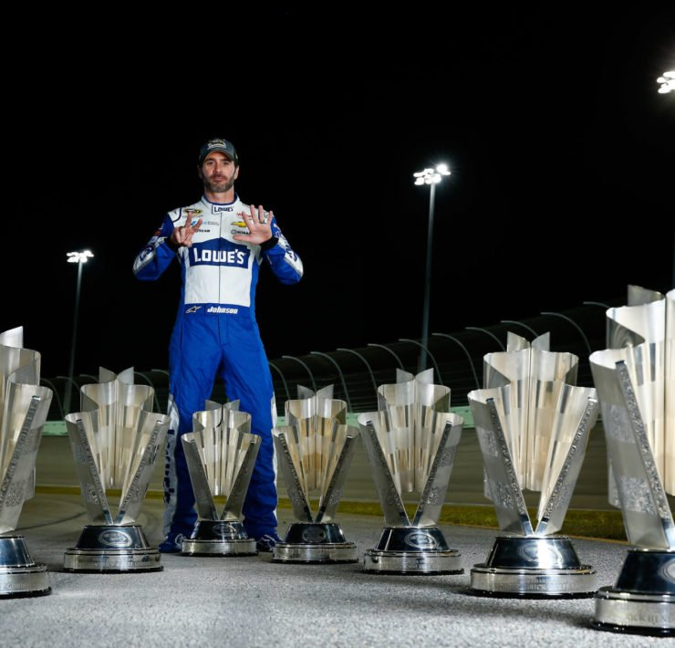 Jimmie Johnson with his NASCAR Cup Seriestrophies collection