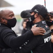 Mercedes' Lewis Hamilton celebrates with his father Anthony after winning the race at Portuguese Grand Prix 2020
