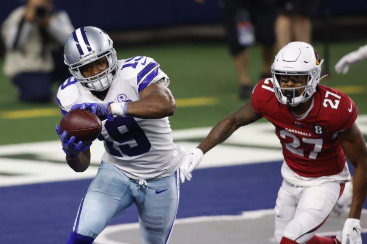 Dallas Cowboys wide receiver Amari Cooper runs with the ball against the Arizona Cardinals.