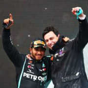 Mercedes' Lewis Hamilton celebrating Championship win with Toto Wolff on the podium