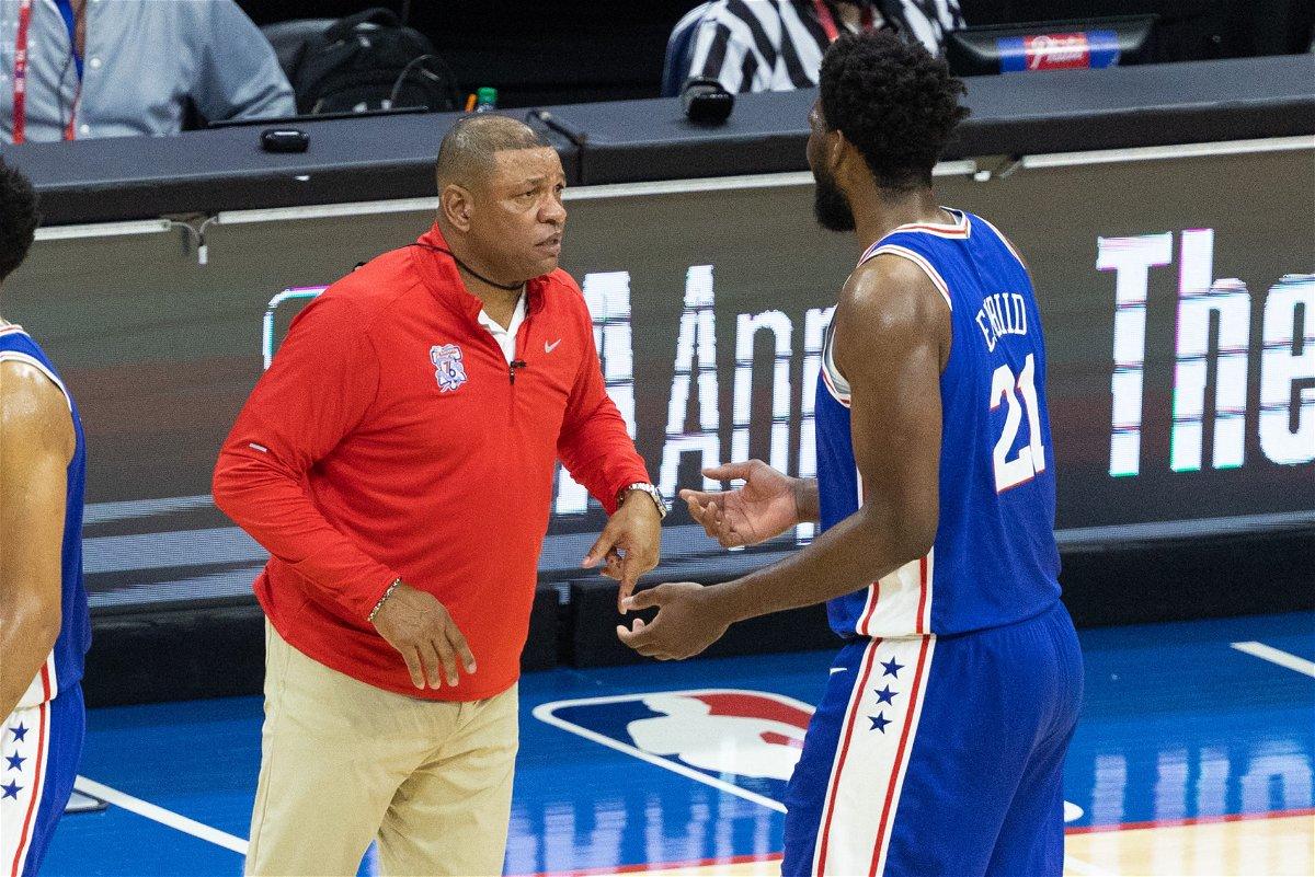 Philadelphia 76ers head coach Doc Rivers talks with center Joel Embiid