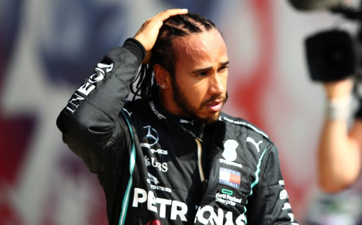 Lewis Hamilton looks on after the 70th anniversary GP race
