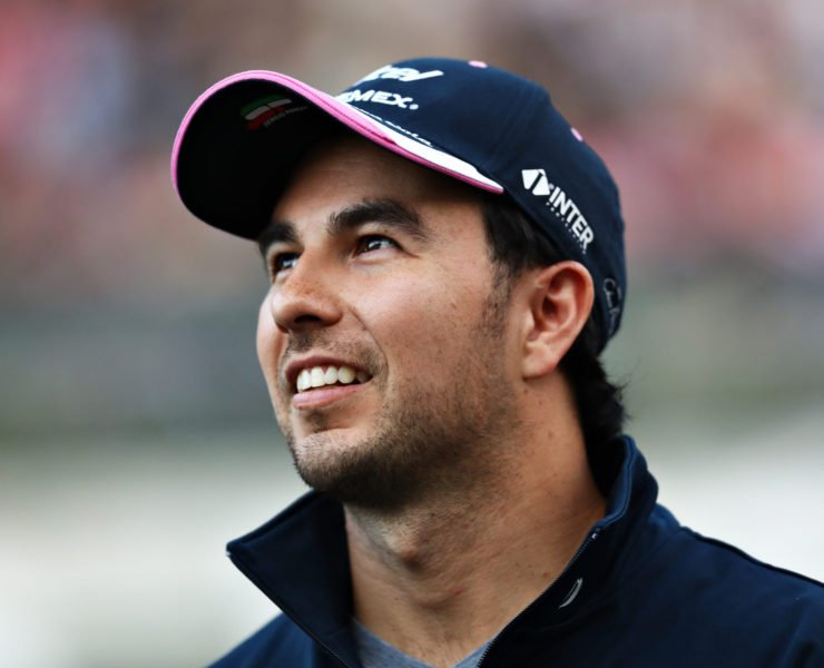 Sergio Perez looks on with a smile in Japan