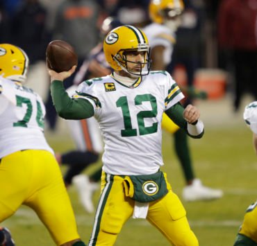Green Bay Packers quarterback Aaron Rodgers attempts a pass against Chicago Bears.