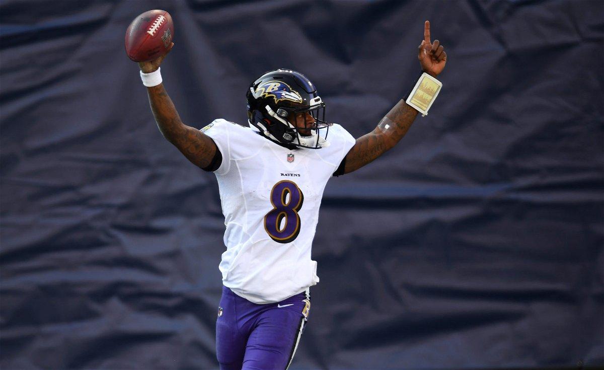 Baltimore Ravens quarterback Lamar Jackson celebrates after scoring a touchdown against Tennessee Titans.
