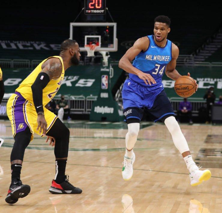 Los Angeles Lakers' LeBron James and Milwaukee Bucks forward Giannis Antetokounmpo
