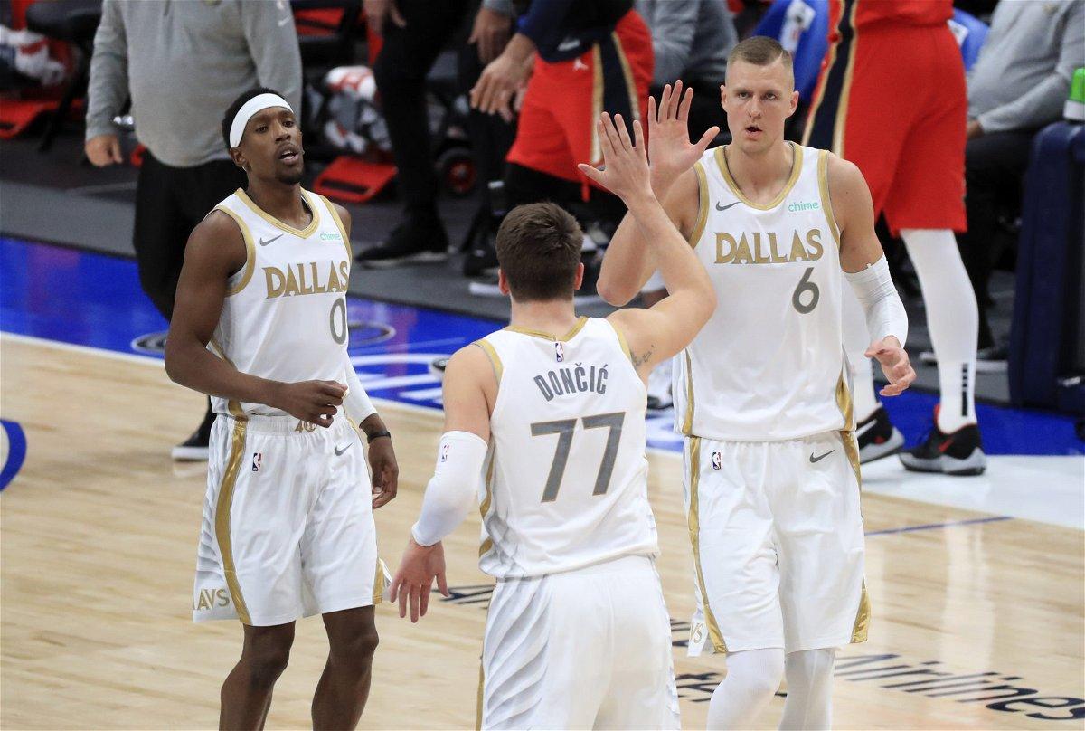 Dallas Mavericks guard Luka Doncic (77) and center Kristaps Porzingis