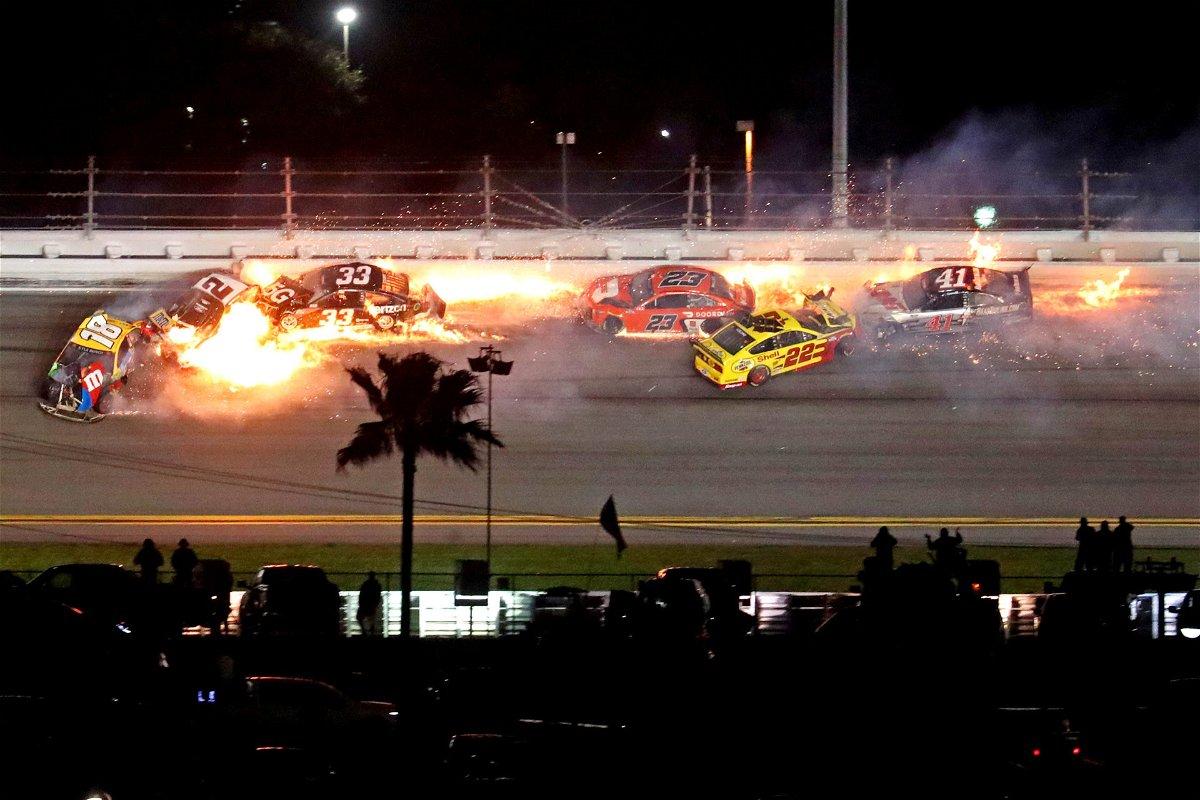 NASCAR drivers Kyle Busch and Joey Logano crash on the final lap of the Daytona 500