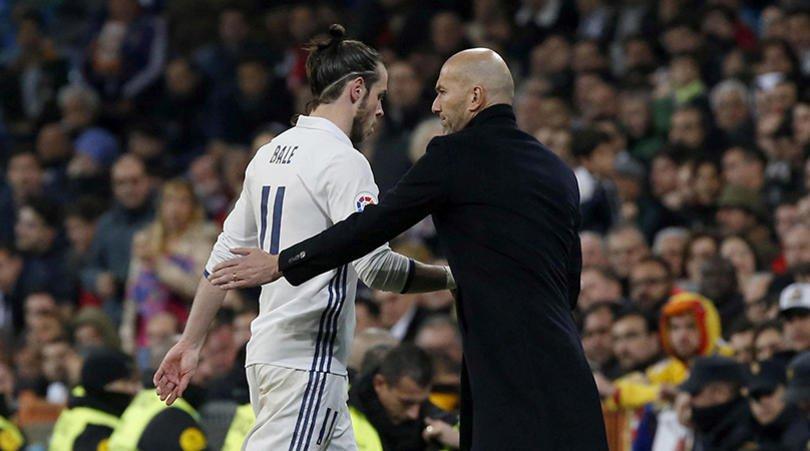 Zinedine Zidane patting Gareth Bale