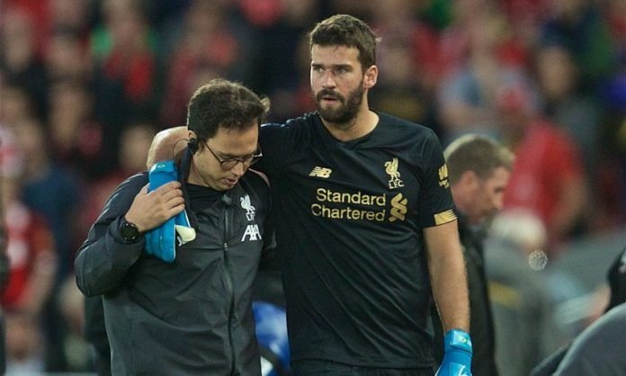 Alisson Becker limping off the field in the Premier League 2019-20 opener