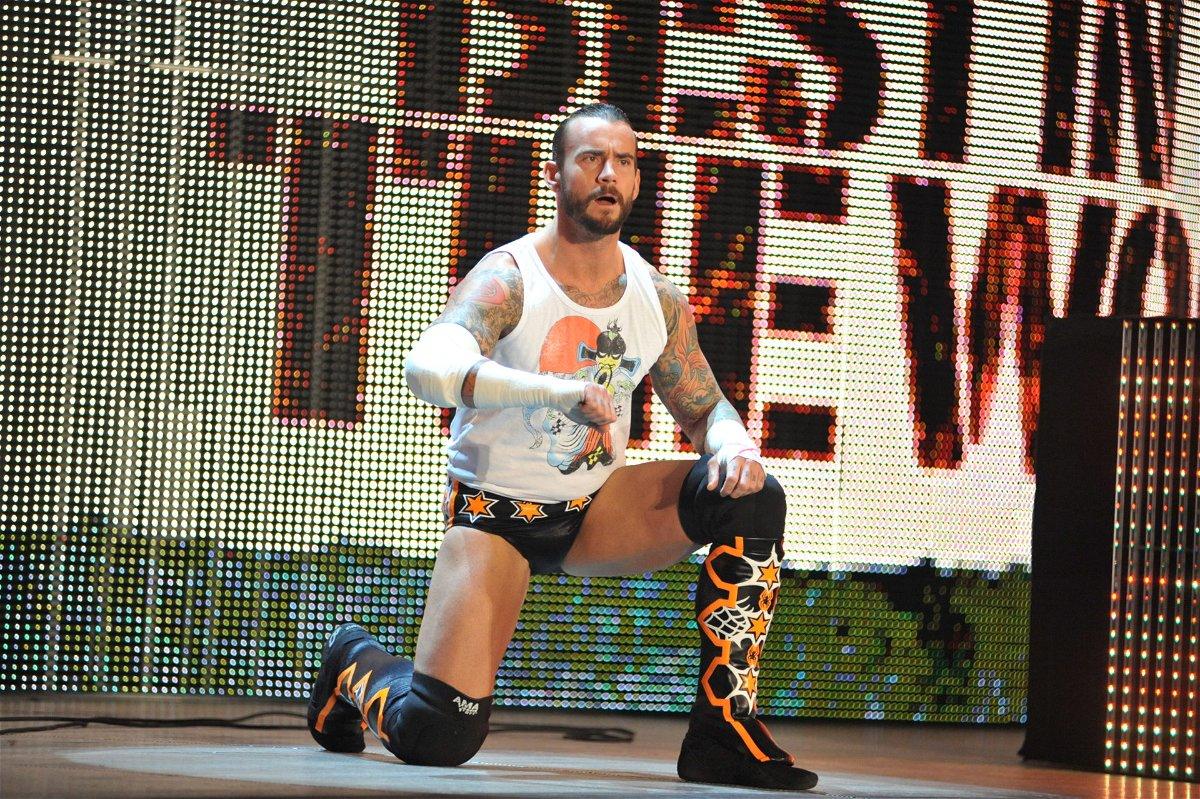 CM Punk does his signature entrance pose