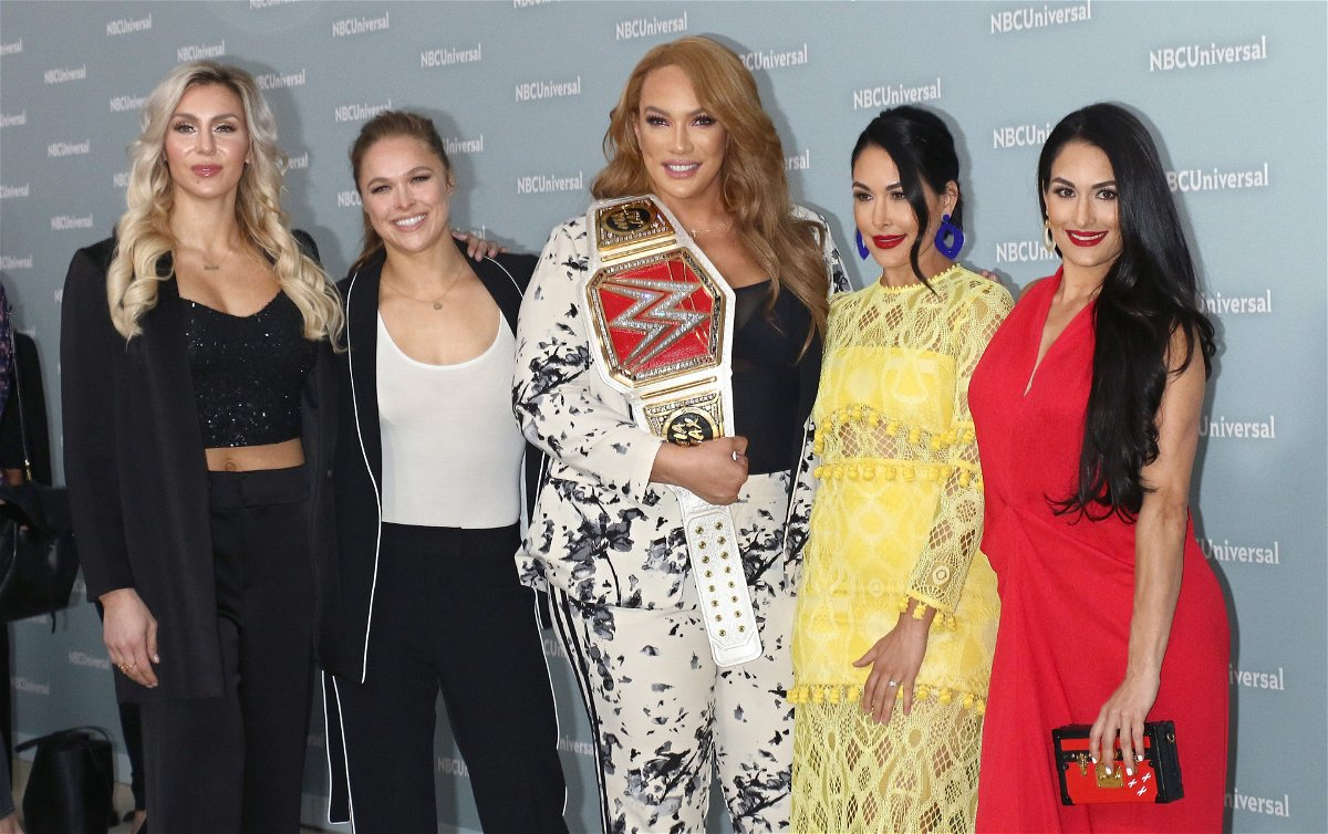 Charlotte Flair Ronda Rousey Nia Jax Bella Twins in a WWE Conference