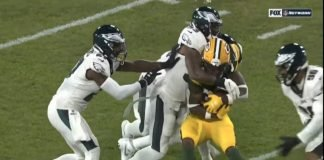 Jamaal Williams getting hit in the head by a collision with Derek Barnett