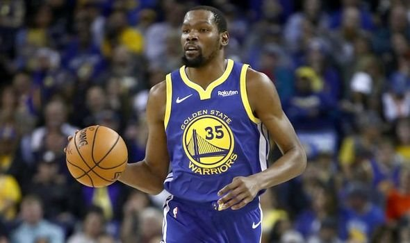 Kevin Durant dribbling in Golden State Warriors jersey