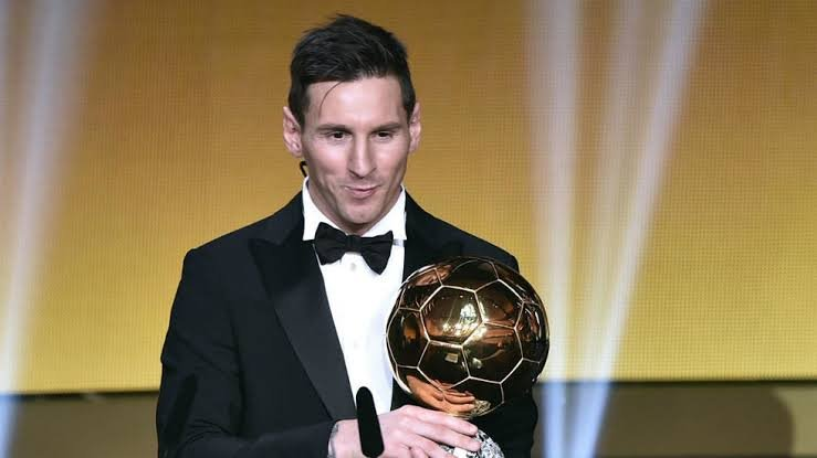 Lionel Messi with the Ballon d'Or Trophy