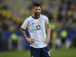 Lionel Messi standing in Argentina jersey