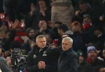 Ole Gunnar Solskjaer patting Jose Mourinho