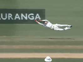 Mitchell Santner making a flying effort to take a catch