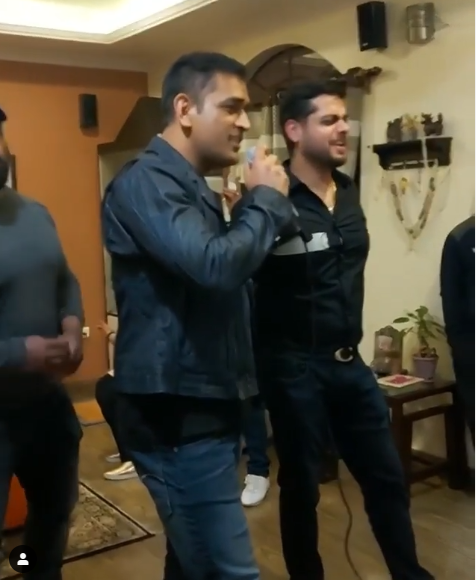 MS Dhoni singing with friends