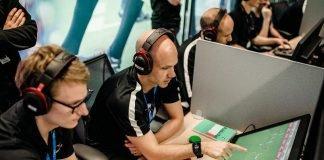 Premier League referee Alex Wallace looking at VAR