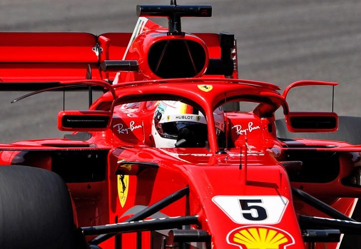 Hamilton stages dramatic comeback but Vettel wins