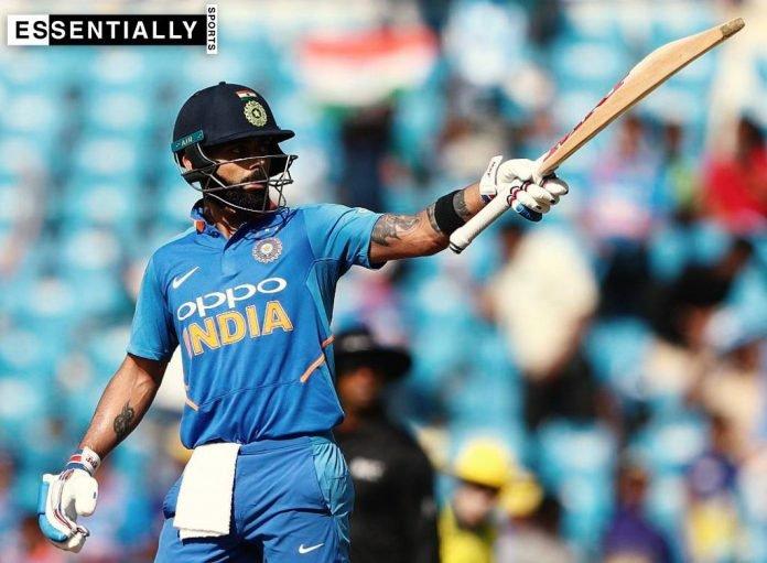 Virat Kohli raising his bat