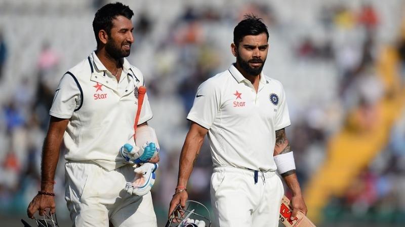 Cheteshwar Pujara and Virat Kohli