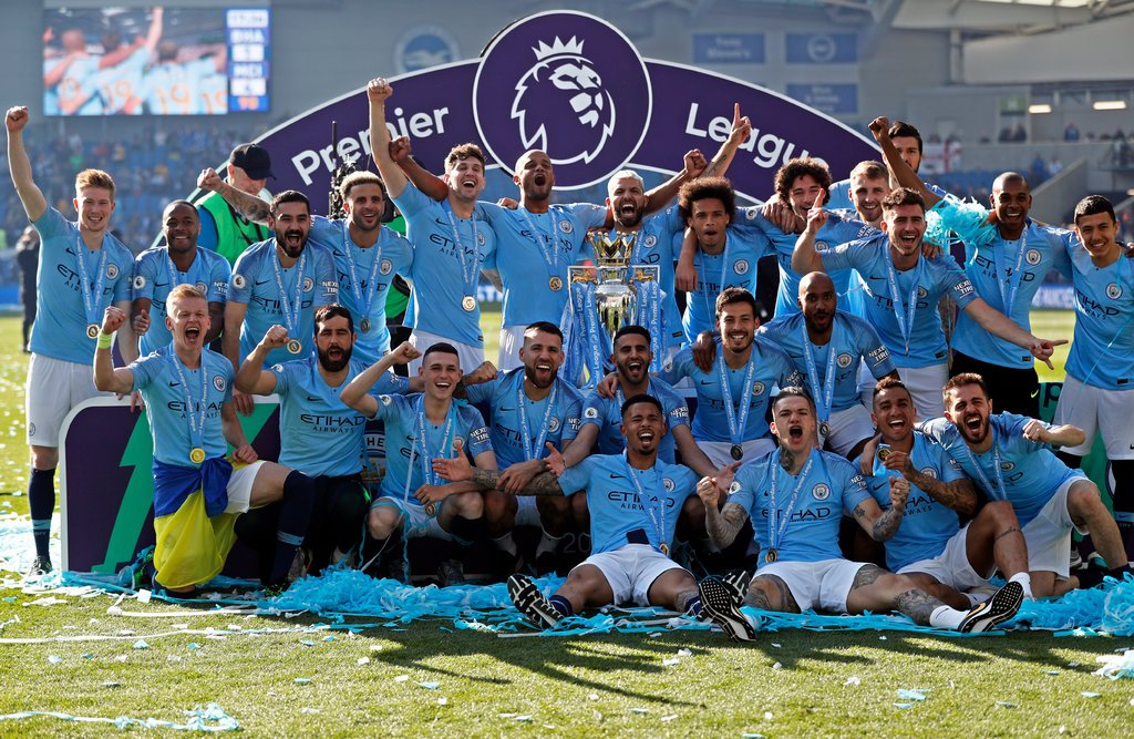 Manchester City with the Premier League trophy