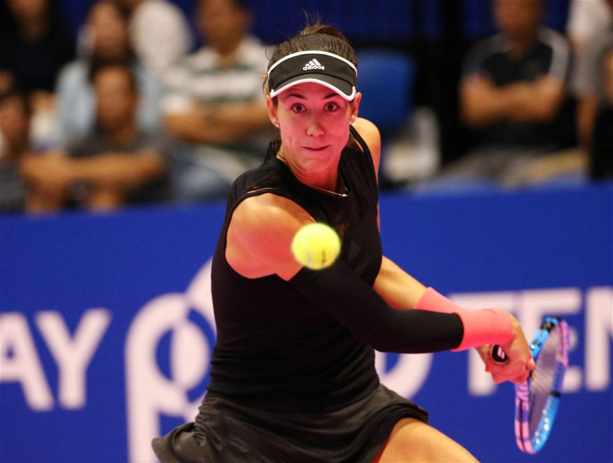 Muguruza returns a backhand