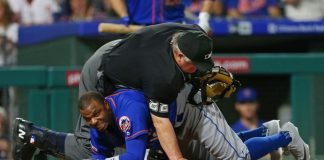 Joe West on Rajai Davies after a collision