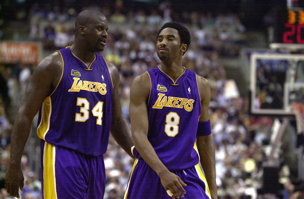 Shaquille O''Neal and Kobe Bryant of the Los Angeles Lakers walk to the bench during a time-out in game five of the NBA Finals against the Philadelphia 76ers at the First Union Center in Philadelphia, Pennsylvania.